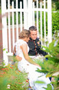 Wedding couple private moment a military sitting alone in a park through the trees Royalty Free Stock Photography