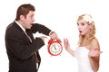 Wedding couple quarreling conflict bad relationships having argument first crisis in marriage groom looking at clock stressed Stock Image