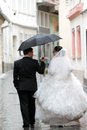 Wedding couple in rain walk with umbrella Royalty Free Stock Photos