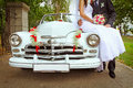 Wedding couple with wedding car Royalty Free Stock Photo