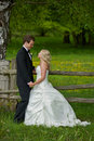 Wedding couple at wooden gate Royalty Free Stock Photography