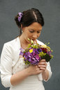 Wedding day beautiful bride looking her flower bouquet absorbed in thought Stock Photos