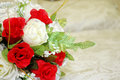 Wedding day bridal bouquet of flowers on the bed Royalty Free Stock Image