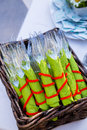 Wedding day utensils are wrapped up and ready to be served with the food at this banquet buffet outdoors Stock Photos