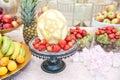 Wedding decoration with fruits on restaurant table, pineapple, bananas, nectarines, kiwi Royalty Free Stock Photo