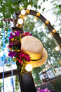 Wedding decoration a strawhat hanging on the mirror for chest of drawers Stock Photography