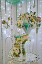 Wedding decorations with cages flowers beads ribbons Stock Images