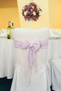 Wedding detail – violet ribbon bow Royalty Free Stock Photo