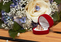 Wedding details: bouquet and rings. Royalty Free Stock Photography
