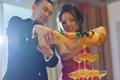 Wedding dinner champagne toasting asian chinese reception bride and groom natural candid photo Royalty Free Stock Photos