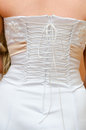 Wedding dress corset lacing of white closeup Stock Image