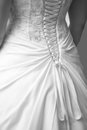 Wedding dress detail back of a has intricate details in lace decor and bow Stock Photos