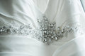 Wedding dress detail photo of jewels and beading on a beautiful Royalty Free Stock Image