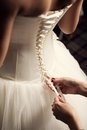 Wedding dress and hands holding ribbon close up image Stock Photo