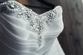 Wedding dress with pearls close up of a Royalty Free Stock Photography