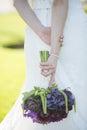Wedding dress purple flower bouquet Royalty Free Stock Photo