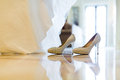 Wedding dress and wedding shoes infront of window Royalty Free Stock Images