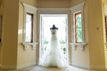 Wedding dress beside the window Stock Photos