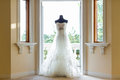 Wedding dress beside the window Stock Images