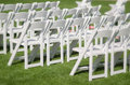 Wedding event seating white chairs green grass Stock Photo