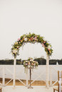 Wedding floral arch on the beach view of Stock Photos