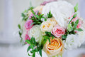 Wedding floristry. Beautiful lush bouquet on the table in restaurant Royalty Free Stock Photo