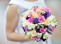 Wedding flowers bloomin bouquet in hands outdoor Royalty Free Stock Image