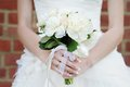 Wedding flowers bouquet bride holding Stock Images