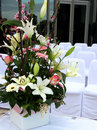 Wedding flowers and chairs Royalty Free Stock Image