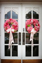 Wedding flowers on the front door of a church Stock Photo