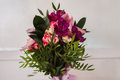 Wedding flowers, wedding bouquet of red and pink peach yellow roses and blue violet purple orchid Royalty Free Stock Photo