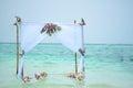 Wedding gazebo tropical flower setup on water lagoon in maldives at maafushi beach with orchids Stock Photos