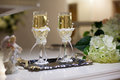 The wedding glasses with champagne on table Royalty Free Stock Photo