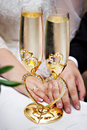 Wedding glasses and hands with rings Stock Image