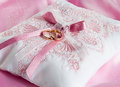 Wedding gold rings on a pillow pink Royalty Free Stock Photo
