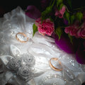 Wedding gold rings on white pillow a Royalty Free Stock Photography