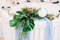 Wedding guest table decorated with bouquet and settings Royalty Free Stock Photo