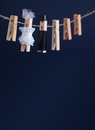 Wedding invitation card with bride and groom clothespin toys on clothesline. Abstract woman in white wedding dress and