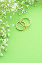 Wedding invitation invite with rings flowers and green background Stock Photo