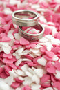 Wedding invite rings with cute sugar hearts in pink and white Royalty Free Stock Photo