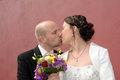 Wedding kiss groom gives a tender to his wife Royalty Free Stock Photo