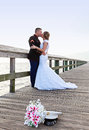 Wedding kiss a military groom in uniform kissing his bride on a boardwalk by the water Royalty Free Stock Photos