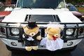 Wedding limousine toys bears as bride groom Stock Photos