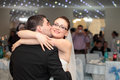 Wedding party kiss newlyweds at in special events hall Royalty Free Stock Photography