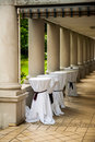 Wedding or party venue preparation with covered bar tables in a luxury ancient corridor Royalty Free Stock Images