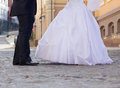 Wedding pavement shoes of a bride and groom walking by the city Royalty Free Stock Photography