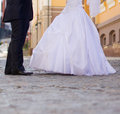 Wedding pavement shoes of a bride and groom walking by the city Stock Images