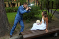 Wedding photo shoot a newlywed with a camera take pictures bri session bridegroom in hand photographing the bride Royalty Free Stock Image