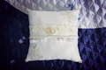 Wedding pillow pair of rings on silk lace closeup Royalty Free Stock Photos