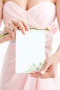 Wedding polygraphy. Invitation in the hands of women. Royalty Free Stock Photo